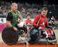 Australia's Ryley Batt (L) collides with Canada's Zak Madell (R) during the Gold medal Wheelchair Rugby match between Canada and Australia at the Basketball Arena during the London 2012 Paralympic Games in the Olympic Park in east London. Australia won the game 66-51