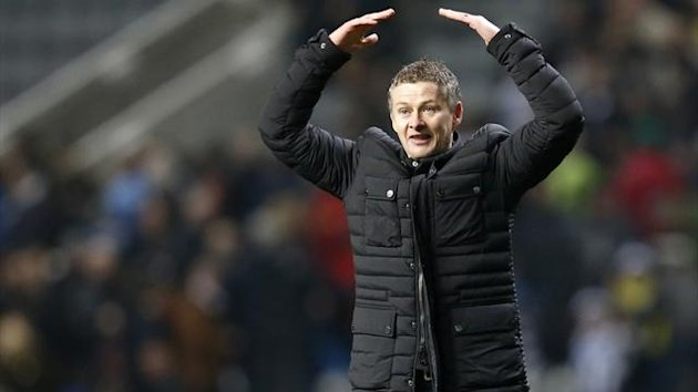 Cardiff City's manager Ole Gunnar Solskjaer celebrates with the team's fans following their English FA Cup match against Newcastle United at St James' Park (Reuters)