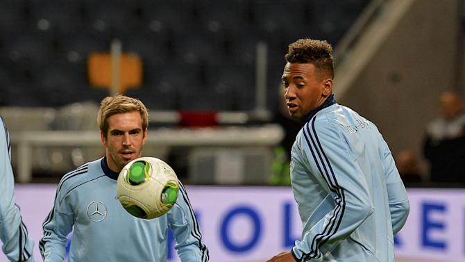 Germany's Philipp Lahm, left and Jerome Boateng during the training at Friends Arena in Stockholm, Sweden, Monday Oct.14, 2013. Germany will play against Sweden in the last soccer World Cup qualifier Tuesday.   (AP Photo / Jonas Ekstromer / TT NEWS AGENCY)