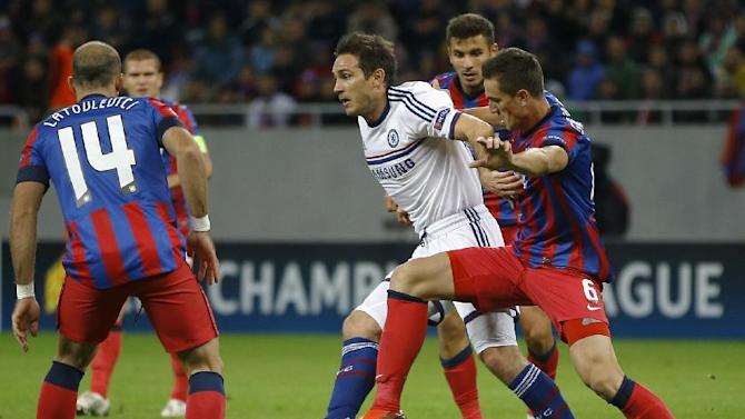 Chelsea's Frank Lampard, center, is challenged by Steaua's Florin Gardos, right, during the soccer Champions League group E match between Steaua Bucharest and Chelsea in Bucharest, Romania, Tuesday, Oct. 1, 2013