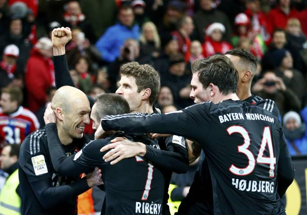 Bayern Munich's Robben celebrates with his teammates after scoring a goal against FSV Mainz 05 during their German first division Bundesliga soccer match in Main