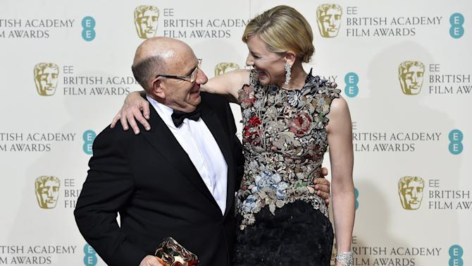Tim Angel poses with Cate Blanchett after winning the award for outstanding British contribution to cinema at the British Academy of Film and Television Arts (BAFTA) Awards at the Royal Opera House in London