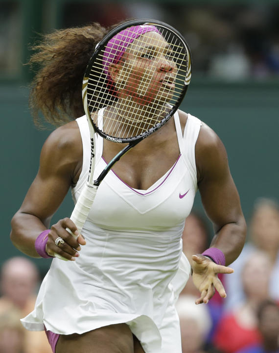 Serena Williams of the United States follows the ball during a quarterfinals match against Petra Kvitova of the Czech Republic at the All England Lawn Tennis Championships at Wimbledon, England, Tuesd