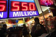 A sign outside the One Stop Mart shows the winning amounts for lottery games in November 2012 in Chicago, Illinois. The $587.5 million jackpot was the largest in Powerball history, with a cash option of $384.7 million before taxes, and the second biggest in US history, after a $656 million payout in the Mega Millions lottery last April