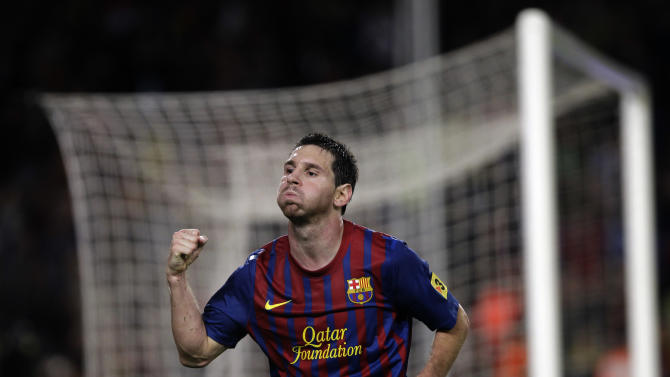 FC Barcelona's Lionel Messi, from Argentina, reacts after scoring against Atletico Madrid during a Spanish La Liga soccer match at the Camp Nou stadium in Barcelona, Spain, Saturday, Sept. 24, 2011. (AP Photo/Emilio Morenatti)