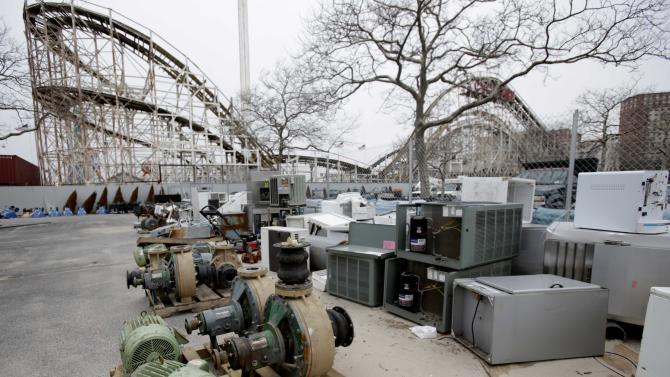 Machinery damaged by Superstorm Sandy is laid out in a parking lot near the Wildlife Conservation Society's New York Aquarium in Coney Island, New York, Monday, March 25, 2013.  (AP Photo/Seth Wenig)