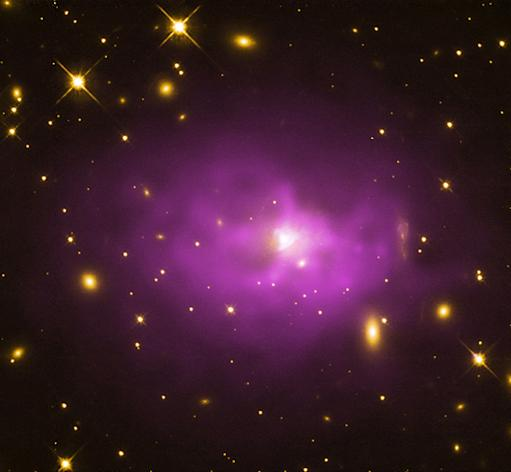 The bright spot at the center of this large elliptical galaxy is one of the biggest black holes in the universe, which scientists recently found is even bigger than previously thought. This galaxy is in the center of the galaxy cluster PKS 0745