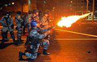 Riot squad officers clash with protestors on a street near Maracana stadium in Rio de Janeiro, Brazil on June 30, 2013. Protesters armed with screwdrivers and slingshots clashed with police near Rio's legendary Maracana football stadium where Brazil defeated Spain to win a third successive Confederations Cup