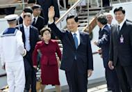 Chinese President Hu Jintao waves after leaving the Danish Royal yacht Dannebrog in Copenhagen. Hu and his wife have visited the Little Mermaid statue in Copenhagen as part of the first ever state visit to Denmark by a Chinese president