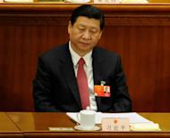 Chinese Vice President Xi Jinping, pictured during the closing ceremony of the National People's Congress (NPC) at the Great Hall of the People in Beijing, on March 14. Xi has called for greater unity in the Party, in a speech published on Friday -- a day after the biggest political drama to hit the country in years