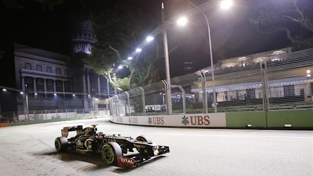 Lotus F1 Formula One driver Raikkonen of Finland drives during the second practice session of the Singapore F1 Grand Prix (Reuters)