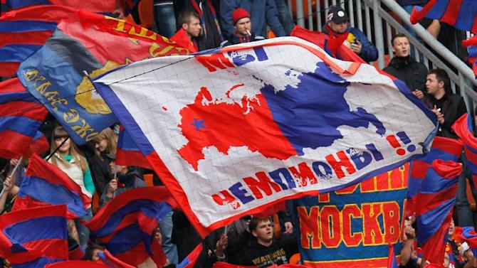 """CSKA Moscow's fans wave their symbols and banner reading """"We are champions!"""" during a Russian Premier League Championship soccer match between CSKA Moscow and Spartak Moscow at the Lokomotiv stadium in Moscow, Russia, Sunday, Sept. 22, 2013. Spartak won 3-0"""