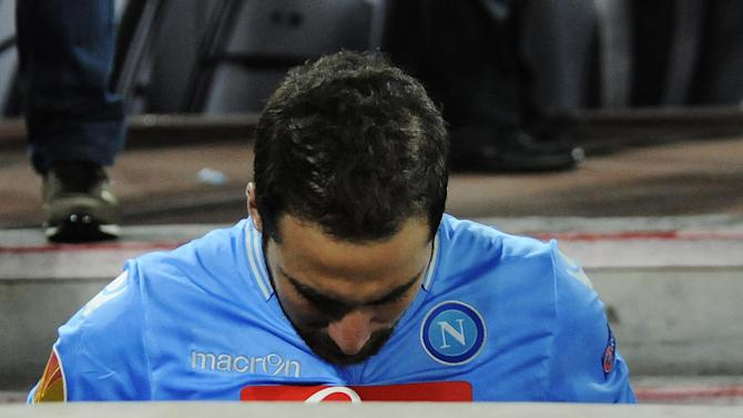 Napoli's Gonzalo Higuain leaves the pitch at the end of the Europa League, round of 16 return-leg soccer match, against Porto at the Naples San Paolo stadium, Italy, Thursday, March 20, 2014