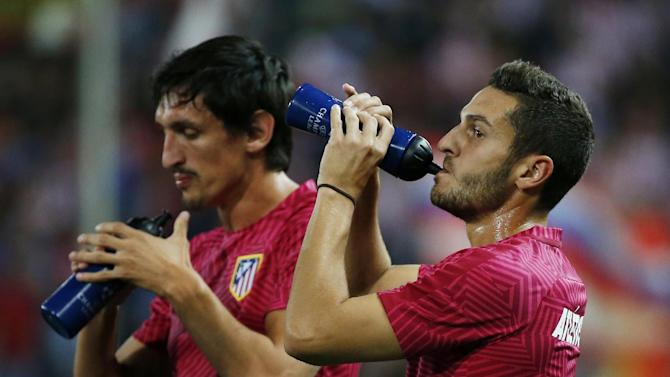 Atletico Madrid's Koke and Stefan Savic before the match