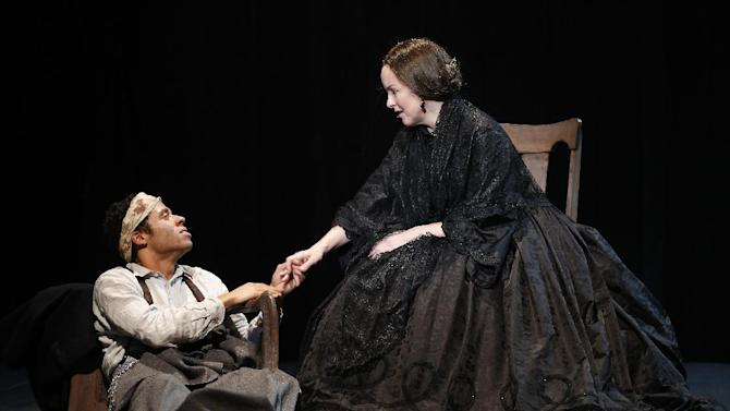 """In this undated publicity photo released by Richard Kornberg & Associates, Jonathan-David, left, and Alice Ripley perform in Paula Vogel's """"A Civil War Christmas,"""" off-Broadway at New York Theatre Workshop in New York.  (AP Photo/Richard Kornberg  & Associates, Carol Rosegg)"""