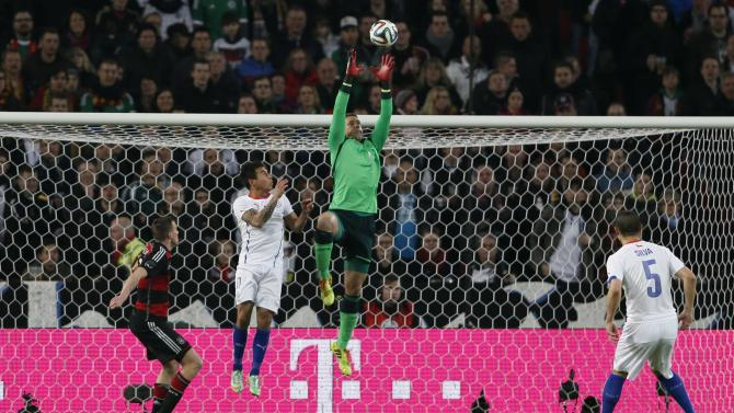 Germany's goalkeeper Manuel Neuer catches the ball during their international friendly soccer match against Chile in Stuttgart