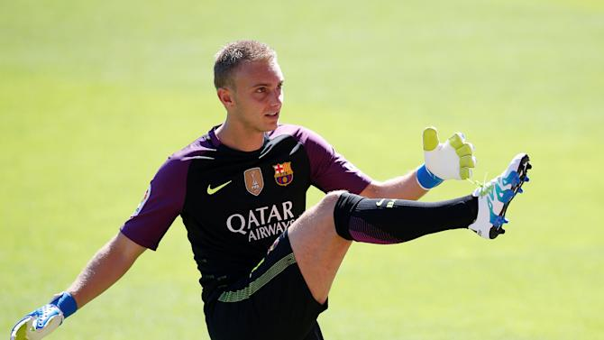 FC Barcelona's newly signed soccer goalkeeper Jasper Cillessen kicks a ball during his presentation at Camp Nou stadium in Barcelona