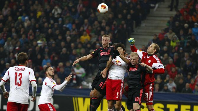 FC Salzburg's goalkeeper Gulacsi saves a ball with teammate Ramalho against Ajax Amsterdam's Van der Hoorn and Klaassen during their Europa League soccer match in Salzburg