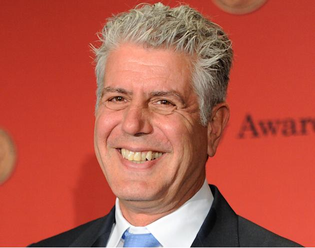 "FILE - In this Monday, May 19, 2014, file photo, Anthony Bourdain poses with his award for CNN's ""Parts Unknown"" at the 73rd Annual George Foster Peabody Awards at the Waldorf-Astoria Ho"