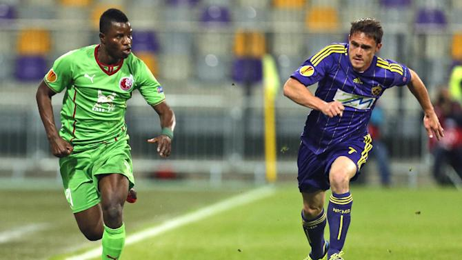 Rubin Kazan's Wakaso Mubarak, left, is challenged by Maribor's Ales Mejac, during their group D Europa League soccer match, in Maribor, Slovenia, Thursday, Sept. 19, 2013