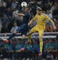 French midfielder Franck Ribery (L) jumps for the ball with Ukrainian midfielder Anatoliy Tymoshchuk during the Euro 2012 championships football match at the Donbass Arena in Donetsk. France won 2-0