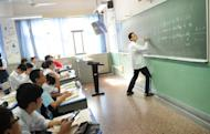 Boys take a maths class at the government-run Number Eight High School in Shanghai, on October 15, 2012. Chinese officials are concerned that some male students may be slower than their female counterparts in development and certain academic areas