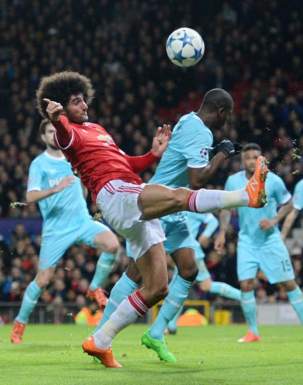 Manchester United's midfielder Marouane Fellaini (foreground) in action during a UEFA Champions League match against PSV Eindhoven at the Old Trafford Stadium on November 25, 2015