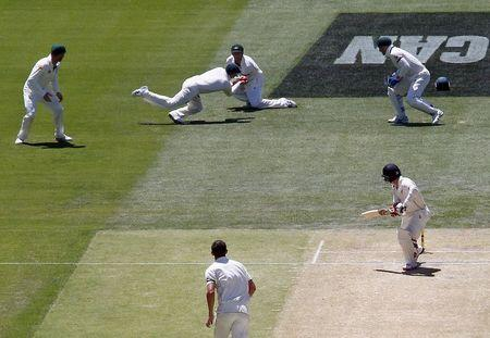 Australia's captain Steve Smith takes a catch in front of team mate Shaun Marsh to dismiss New Zealand's Bradley-John Watling for seven runs during the third day of the third cricket test matc