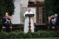 Pope Francis delivers his message as he is flanked by Israel's President Shimon Peres, left, and Palestinian President Mahmoud Abbas during an evening of peace prayers in the Vatican gardens, Sunday, June 8, 2014. Pope Francis waded head-first into Mideast peace-making Sunday, welcoming the Israeli and Palestinian presidents to the Vatican for an evening of peace prayers just weeks after the last round of U.S.-sponsored negotiations collapsed. (AP Photo/Gregorio Borgia)