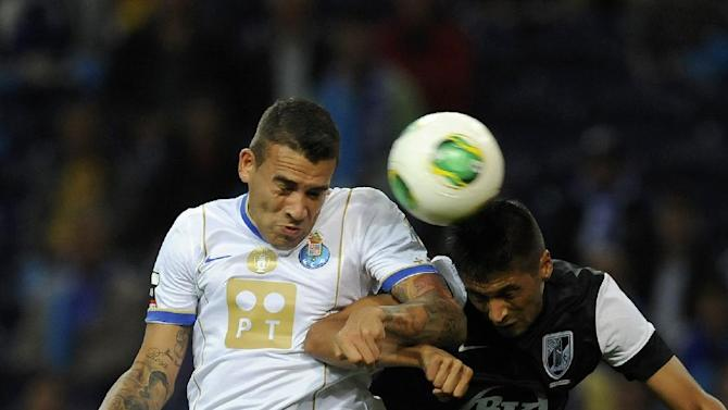 "FC Porto's Nicolas Otamendi, from Argentina, challenges for a high ball with Vitoria Guimaraes' Joao ""Moreno"" Teixeira, right, in a Portuguese League soccer match at the Dragao Stadium in Porto, Portugal, Friday, Sept. 27, 2013"