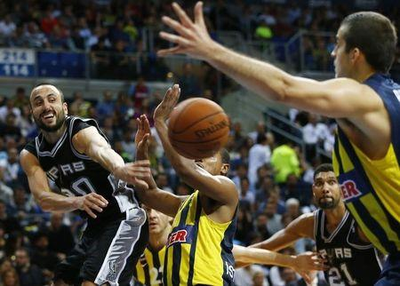 Spurs' Ginobili challenges Fenerbahce Ulker's Goudelock and Bjelica during their NBA Global Games Istanbul 2014 basketball game in Istanbul
