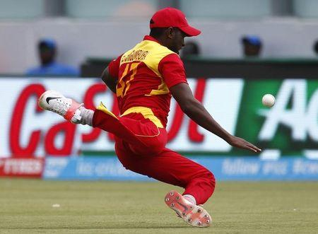 Zimbabwe Captain Elton Chigumbura misses an attempted catch off West Indies batsman Chris Gayle during their World Cup Cricket match in Canberra