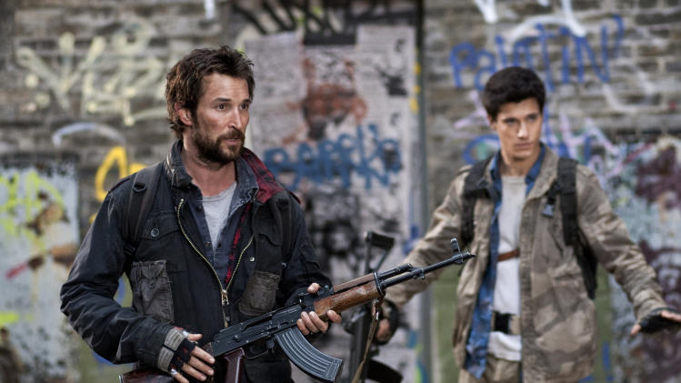 "This image released by TNT shows Noah Wyle, left, and Drew Roy in a scene from the sci-fi series ""Falling Skies,"" which premieres Sundays, at 9 p.m. EDT on TNT. (AP Photo/TNT, Ken Woroner)"