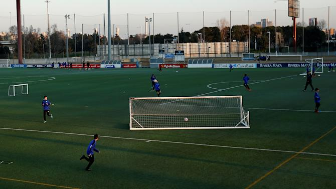 Boys from the RCD Espanyol soccer academy practice during a training session at Dani Jarque training camp in Sant Adria de Besos, Spain