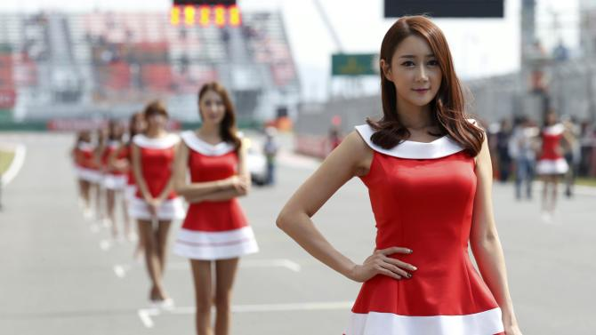 Formula One grid girls stand before the third practice session of the Korean F1 Grand Prix in Yeongam