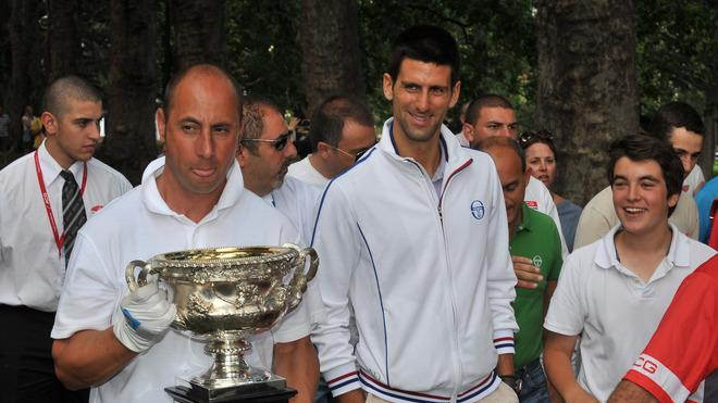 Novak Djokovic Of Serbia (C) Walks AFP/Getty Images