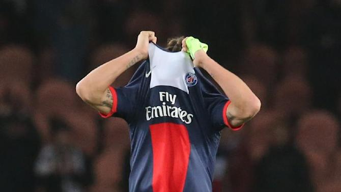 PSG's Zlatan Ibrahimovic takes his jersey off at the end of his Champions League group C soccer match against Anderlecht in Paris, France, Tuesday, Nov. 5, 2013. The match ended in a 1-1 draw