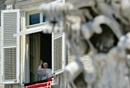 Pope Benedict XVI blesses the pilgrims gathered on St. Peter's square, from the window of his apartments, during the Sunday Angelus prayer. Pope Benedict XVI admitted Sunday that cases of child abuse by paedophile priests had undermined the Roman Catholic Church's credibility in Ireland