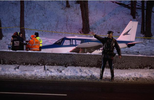 Single engine plane is seen amid vehicle traffic on the Major Deegan Expressway in the Bronx borough of New York