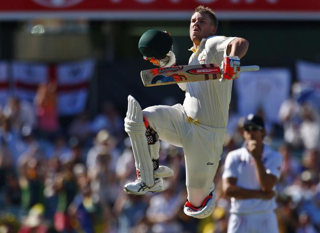 Australia's Warner celebrates his century during the third day of the third Ashes test match against England in Perth