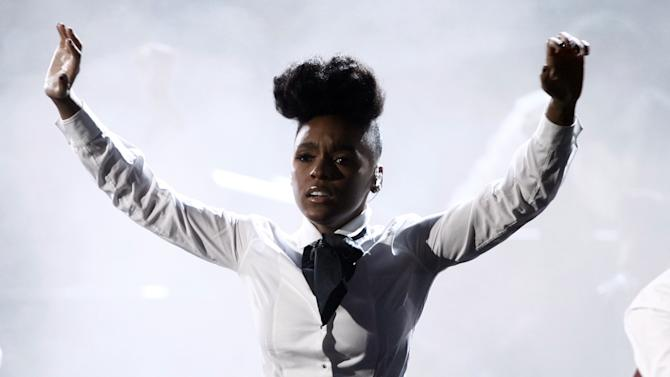 FILE - In this Feb. 13, 2011 file photo, Janelle Monae performs at the 53rd annual Grammy Awards in Los Angeles. Monae says she's an avid thrift shopper, namedropping stores like Little Five Points, Ragarama and Poor Little Rich Girl as her favorites in her Atlanta hometown. (AP Photo/Jae C. Hong)