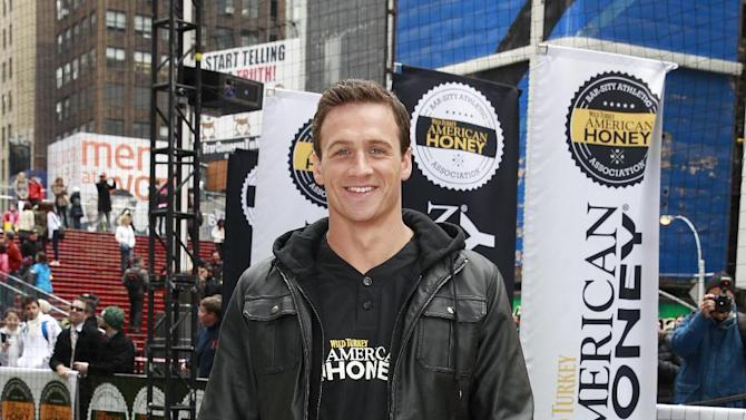 IMAGE DISTRIBUTED FOR AMERICAN HONEY - Eleven time Olympic medalist and TV star Ryan Lochte hosts the first ever American Honey Bar-sity Athletics kickball game in Times Square, on Tuesday, April, 23, 2013 in New York City, New York. (Photo by Mark Von Holden/Invision for American Honey/AP Images)