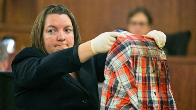 State Police forensic scientist Sherri Menendez holds up a shirt recovered from from the body of Odin Lloyd during State Police forensic scientist Sherri Melendez holds up a shirt recovered from from the body of Odin Lloyd during the murder trial for form