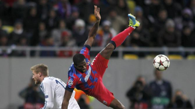 Steaua Bucharest's Varela challenges Chelsea's Schuerrle during their Champions League soccer match at the National Arena in Bucharest