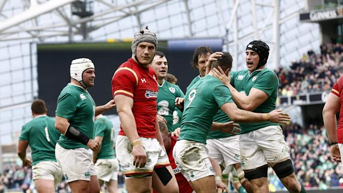 Conor Murray celebrates with team mates after scoring the first try for Ireland