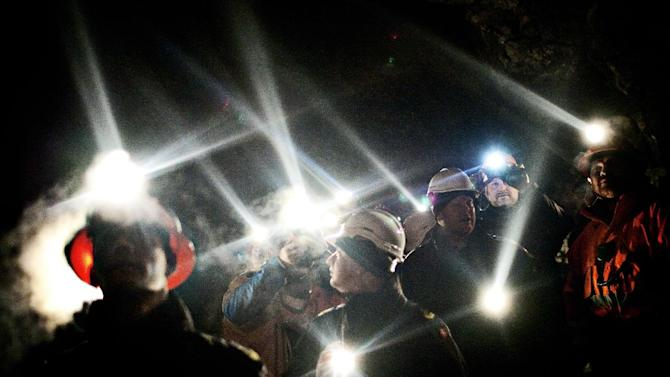FILE - In this Dec. 19, 2009 file photo, people inside the gold mine in Nulanaq mountain Greenland. Greenland's underground wealth is at the forefront of the Arctic island's parliamentary election on Tuesday, March 12, 2013 amid worries over a potential influx of Chinese labor and the environmental consequences of mining. (AP Photo/Polfoto, Joachim Adrian, File) DENMARK OUT