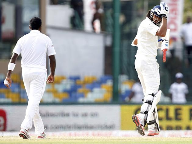 India's Sharma argues with Sri Lanka's Prasad during the fourth day of their third and final test cricket match in Colombo