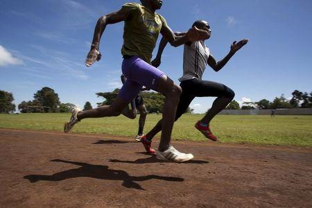 Athletes sprint during a training session on a dirt track in the town of Iten in western Kenya
