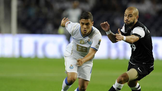 FC Porto's Juan Quintero, from Colombia, escapes from Vitoria Guimaraes' Andre Andre, right, in a Portuguese League soccer match at the Dragao Stadium in Porto, Portugal, Friday, Sept. 27, 2013