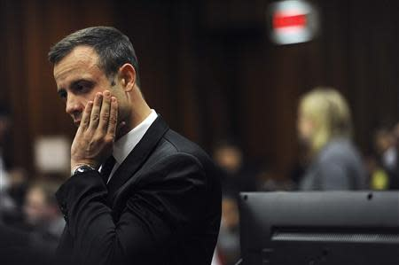 Olympic and Paralympic track star Oscar Pistorius reacts during the fourth day of his trial for the murder of his girlfriend Reeva Steenkamp at the North Gauteng High Court in Pretoria